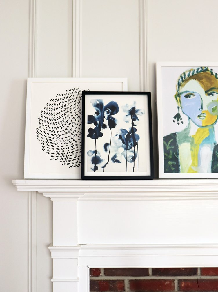 White Fireplace Mantle with Contemporary Print Art on Chairish.