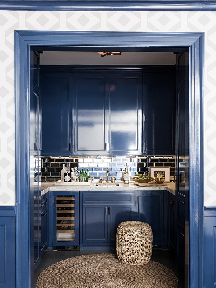 Classic Kitchen with Navy Blue Cabinets and Rattan Circular Rug with Rattan Stool