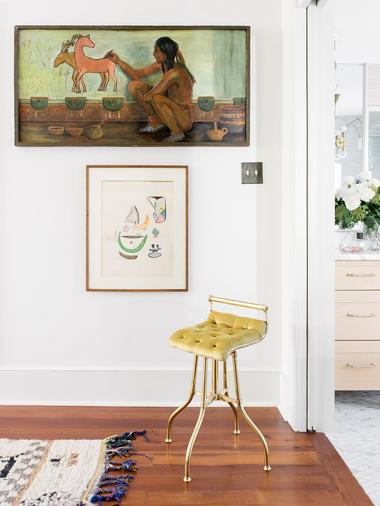 Master Bedroom with Vintage Brass Stool and Large Vintage Paintings on Chairish.