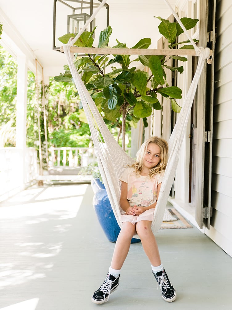 young Girl Sitting in Bohemian White Hanging Deck Chair on Chairish.