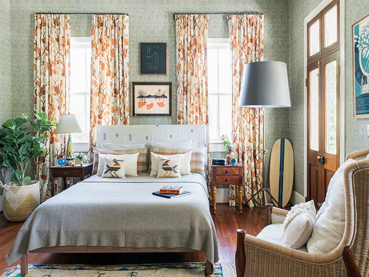 bohemian Guest Bedroom with Vintage Hanging Art and Decorative Skateboard.