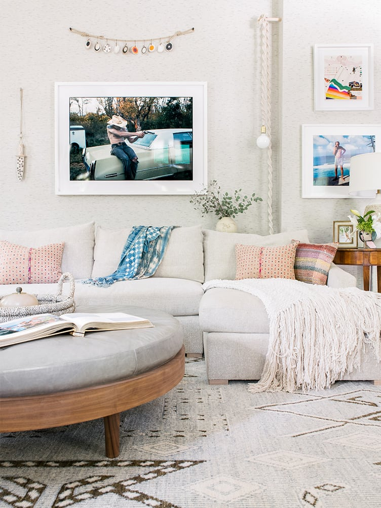 Bohemian Living Room With Beige Color Scheme and Vintage Hanging Photographs.