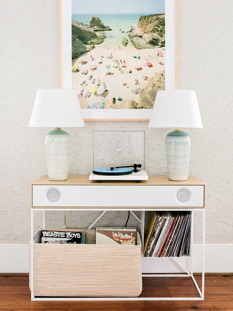 Coffee table With Vintage Record Player and Baskets Containing a Mix of Old Records.