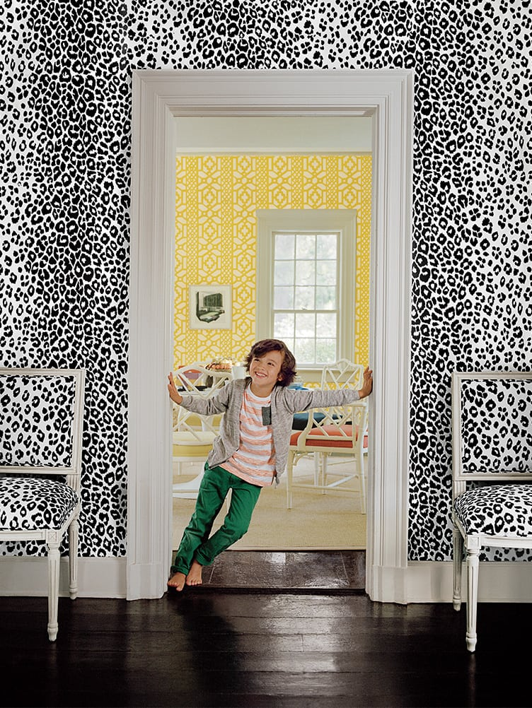 Home Living Room With Black and White Animal Print Wallpaper and Matching Chairs