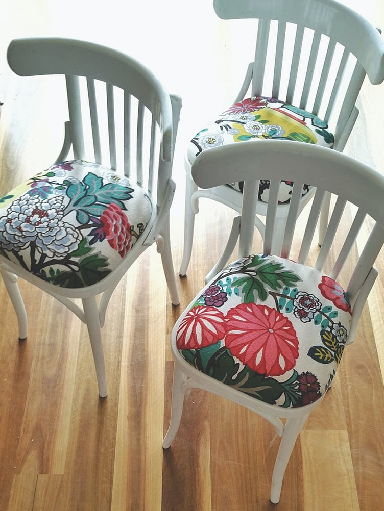 Set of Three White Wooden Kitchen Chairs with Floral Print Cushions on Chairish.