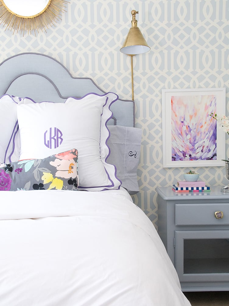 Contemporary Bedroom with Monogrammed Pillows and Blue Headboard and Abstract Art