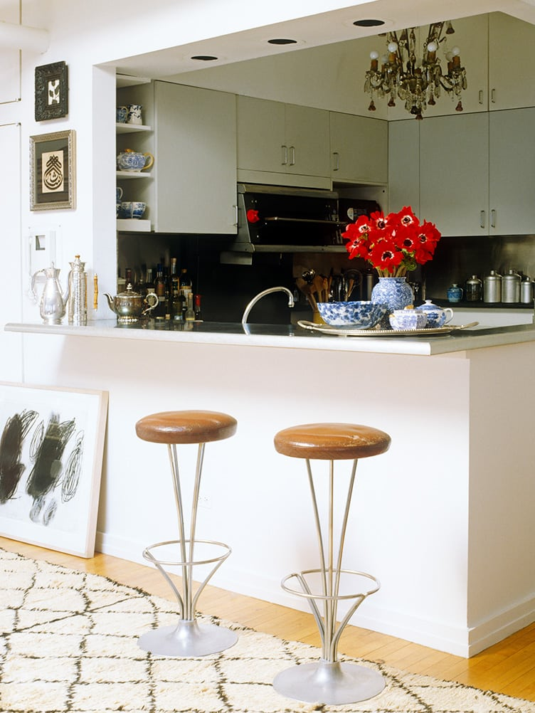 Kitchen With Art Deco Bar Stools and Vintage Chandelier on Chairish.