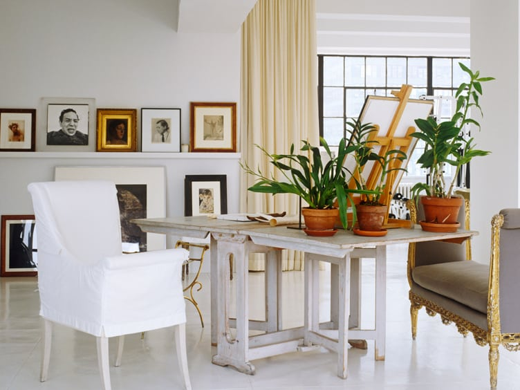 Minimalist Living Room With White Wooden Drop Leaf Table and Vintage Artwork
