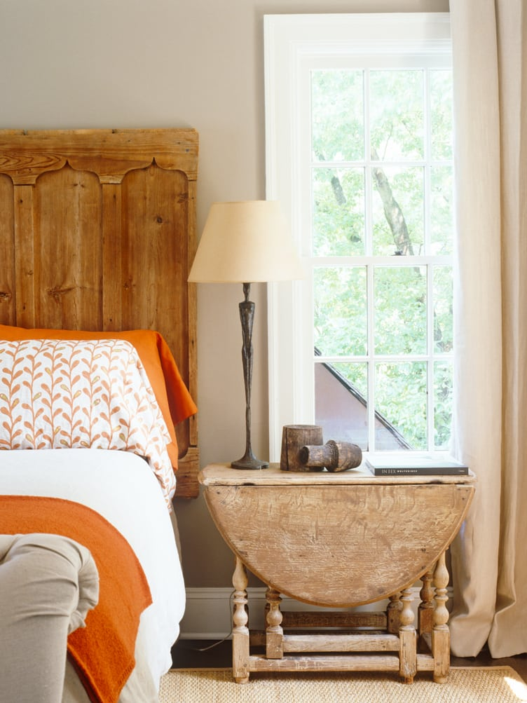 Rustic Traditional Bedroom with Wooden Headboard and Wooden Drop Leaf Side Table.