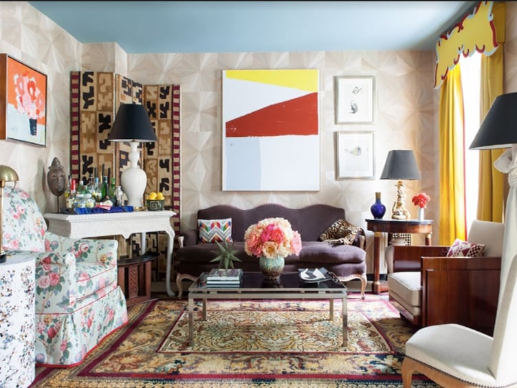 Eclectic Living Room with Patterned Upholstery and Rug and Vintage Wall Art