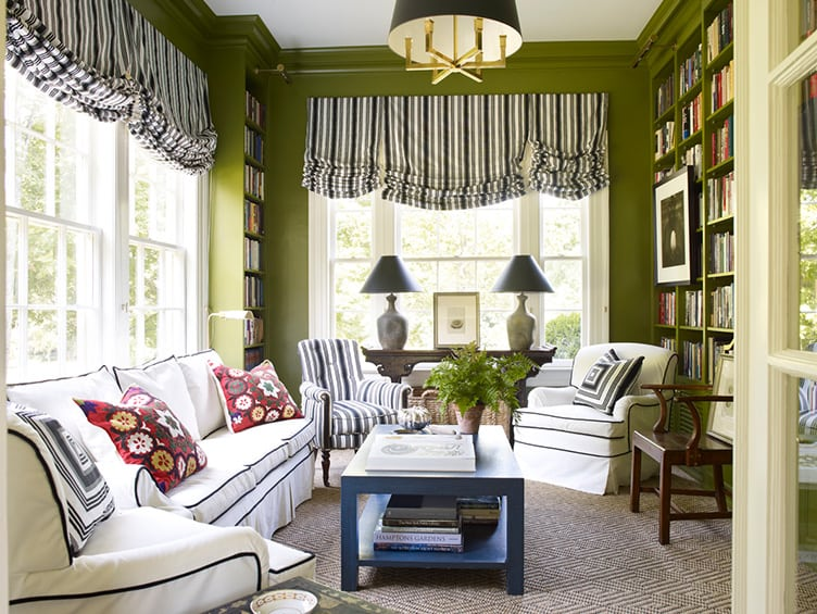 Traditional Living Room with green Walls and Built in Bookshelves.