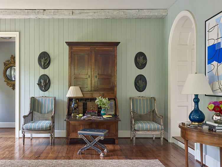 Traditional Rustic Living Room with Wooden Secretary Desk and Matching Vintage Armchairs