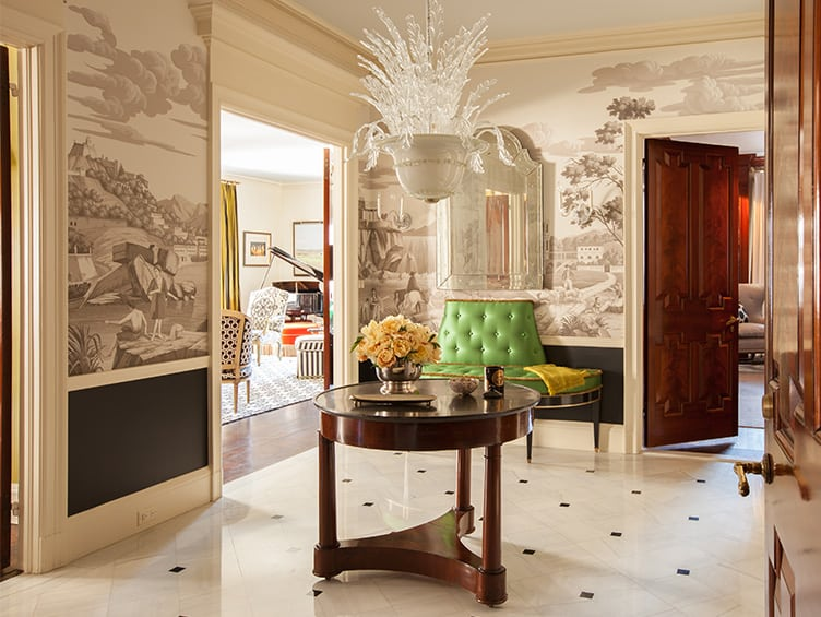Glamorous Entryway with Landscape Wallpaper and Crystal Chandelier.
