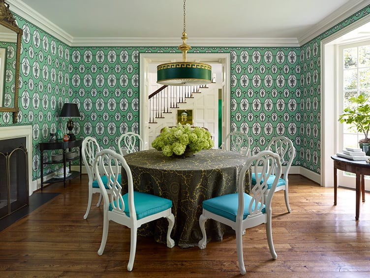 Traditional Dining Room with Statement Wallpaper and Gold and Green Hanging Lamp.