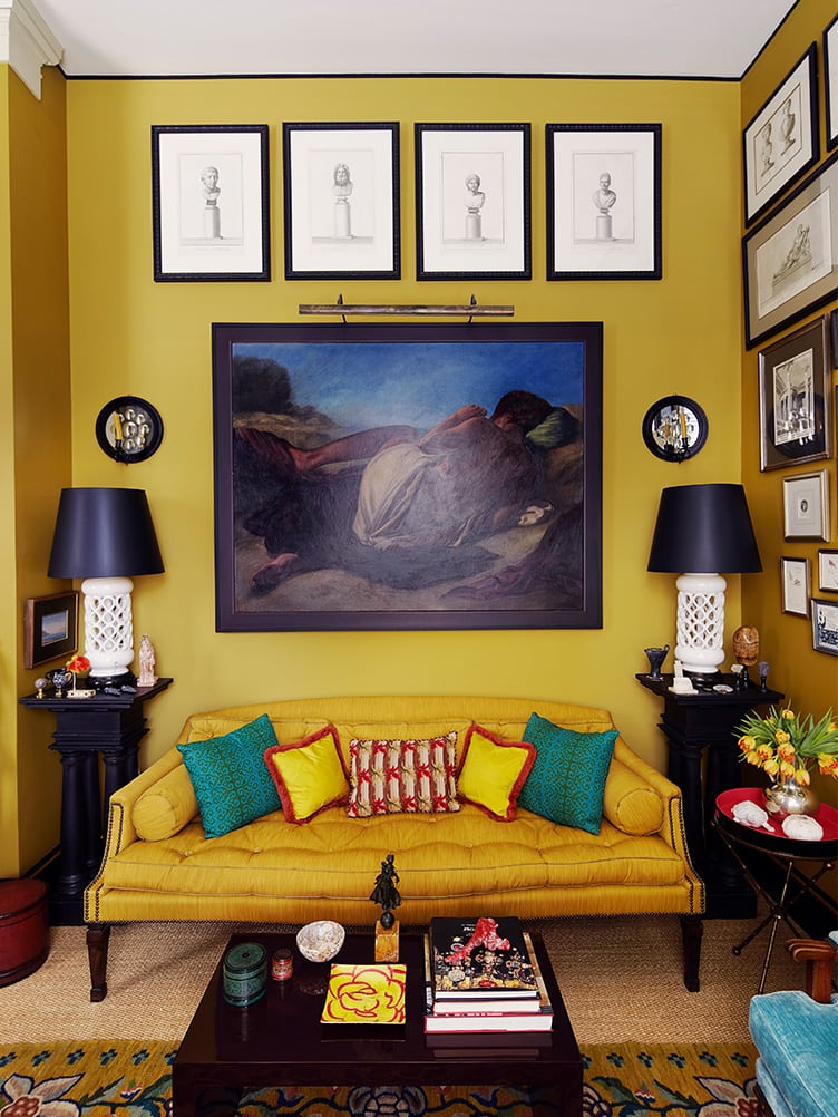 Traditional Living Room with Mustard Walls and Vintage Gallery Wall.
