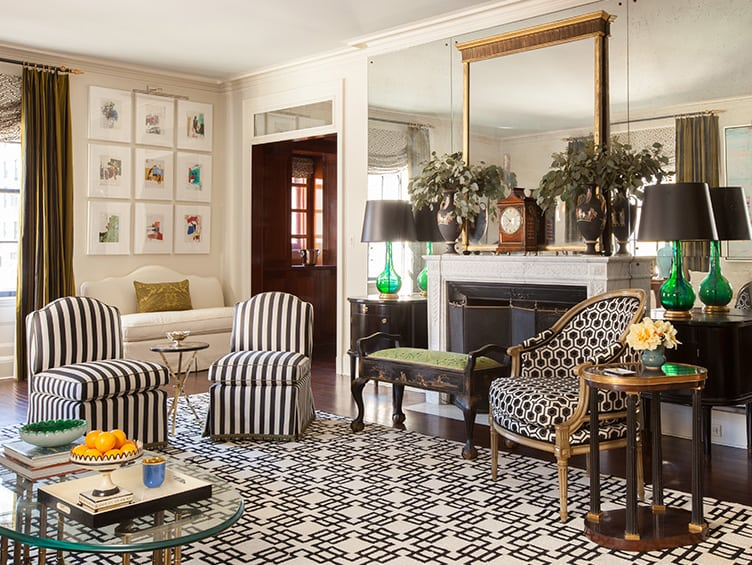 Eclectic Living Room With Black and White Patterned Upholstery and Rug.