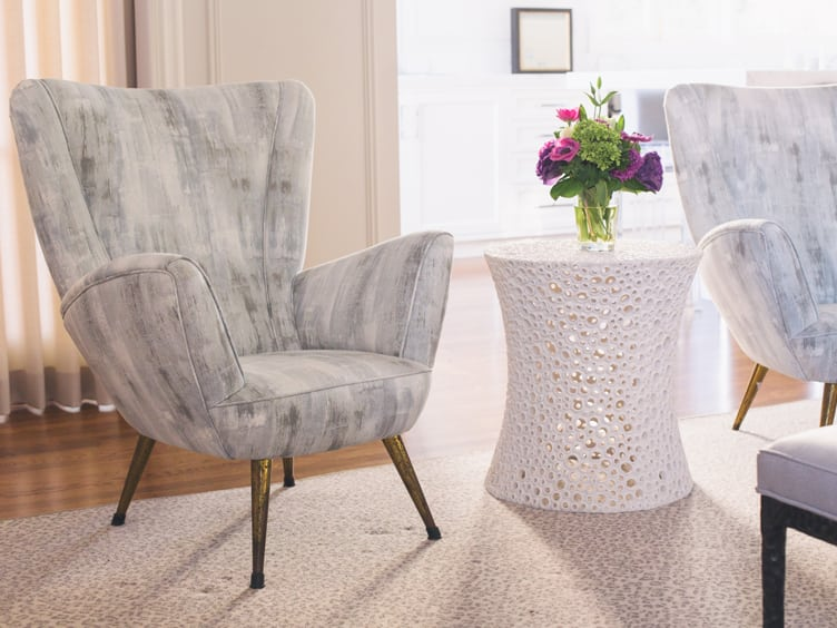 Mid Century Modern Armchair with a Mix of Shades of Grey and a Textured White Coffee Table on Chairish.