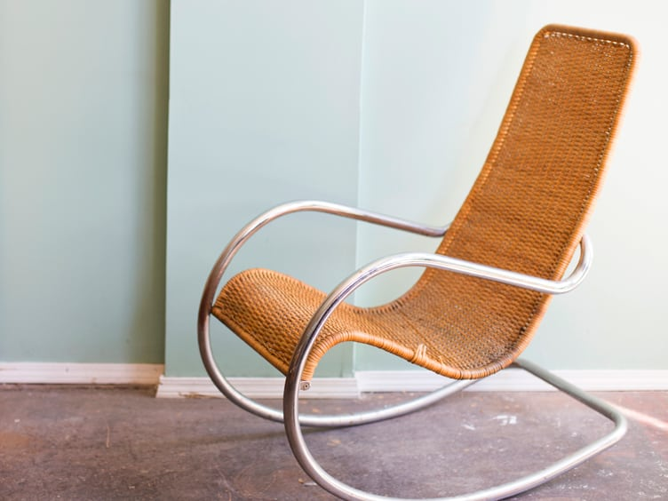 Mid Century Modern Wicker Rocking Chair With Metal Arms and Rocker on Chairish.