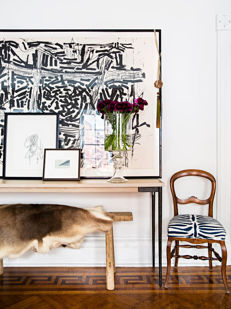 Large Black and White Abstract Geometric Art Next to Wooden Bench With Fur Throw Blanket.