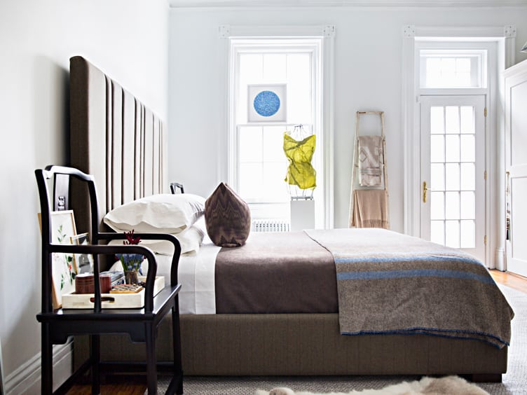 Master bedroom With Large Grey Headboard and Grey Bed Spread on Chairish.