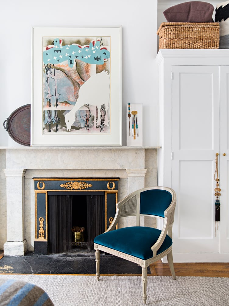 Elegant Living Room with Marble Fireplace and Abstract Contemporary Art on The Mantle.