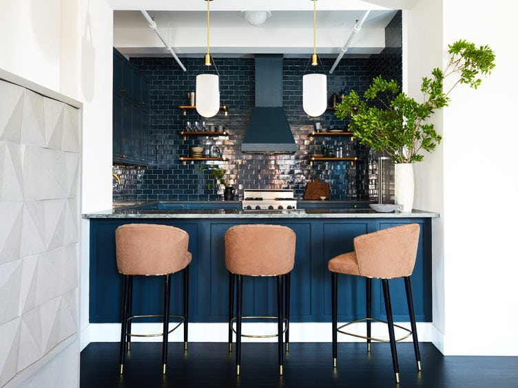 Modern Kitchen with Marble countertop and Three Pink Velvet Bar Stool.s