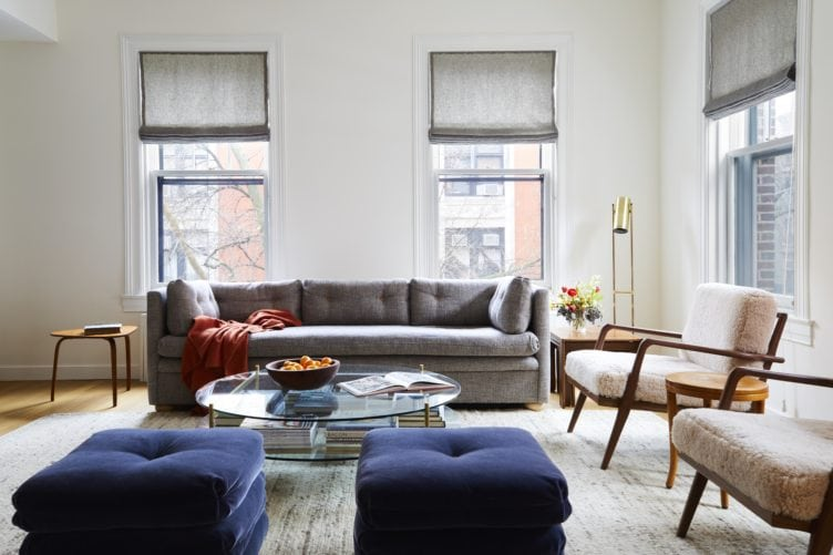 Contemporary Modern Living Room with Glass Coffee Table and Grey Sofa.