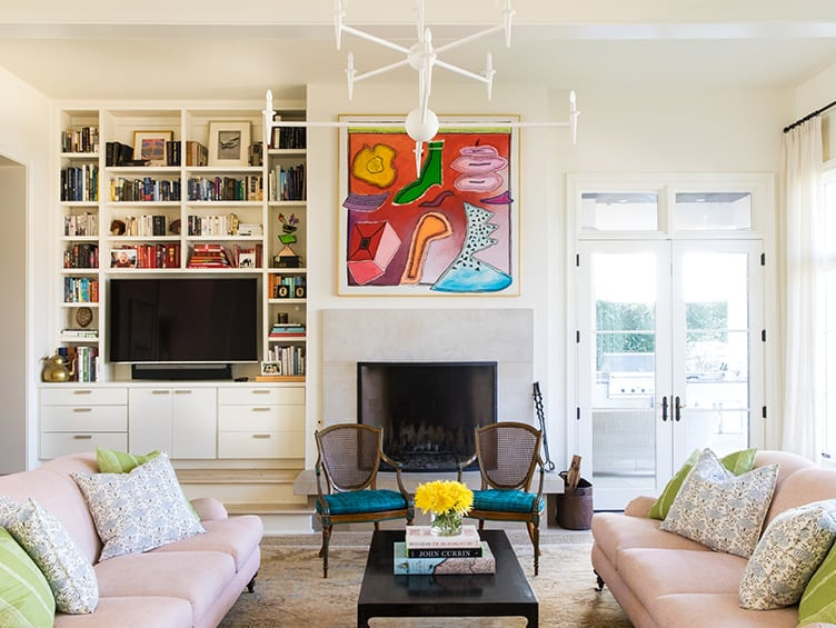 Living Room with Set of Pink Couches and Minimalist White Chandelier on Chairish