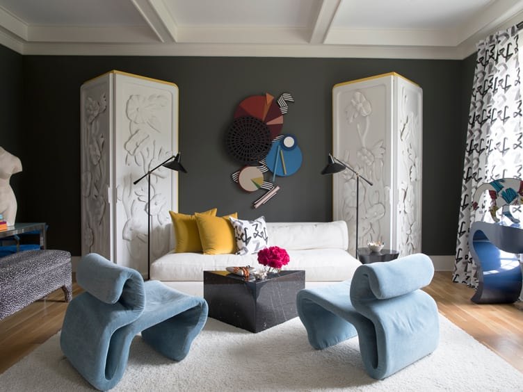 Contemporary Modern Living Room with Blue Velvet Chairs and Abstract Geometric Wall Sculpture.