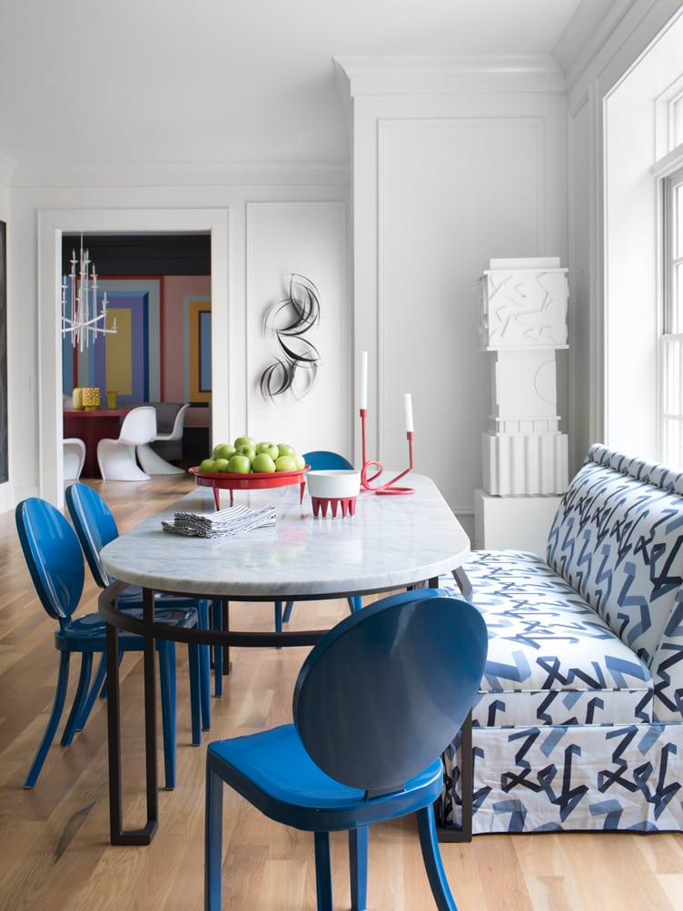 Contemporary Modern Kitchen Dining Area With Marble Table and Blue Patterned Bench.