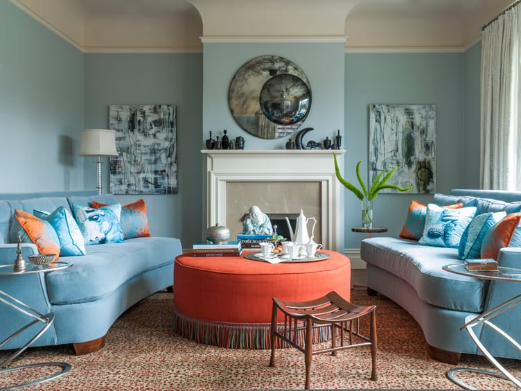 Living Room with Round Cushioned Coffee Table with Multicolored Fringe