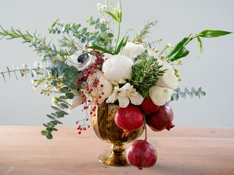 holiday centerpiece ideas pomegranate white rose flowers red green gold arrangement