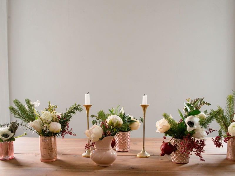 holiday centerpiece ideas brass gold candlesticks white green floral arrangements berries
