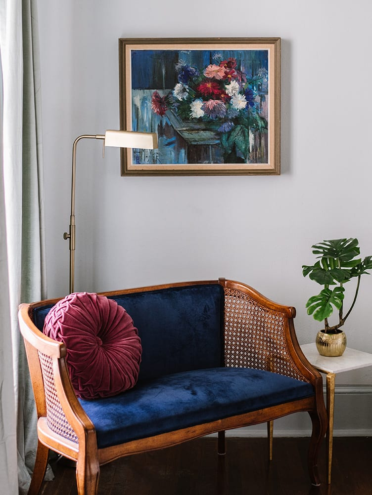 Navy Blue Velvet Sofa With Pink Velvet Pillow and Vintage Painting on Chairish.