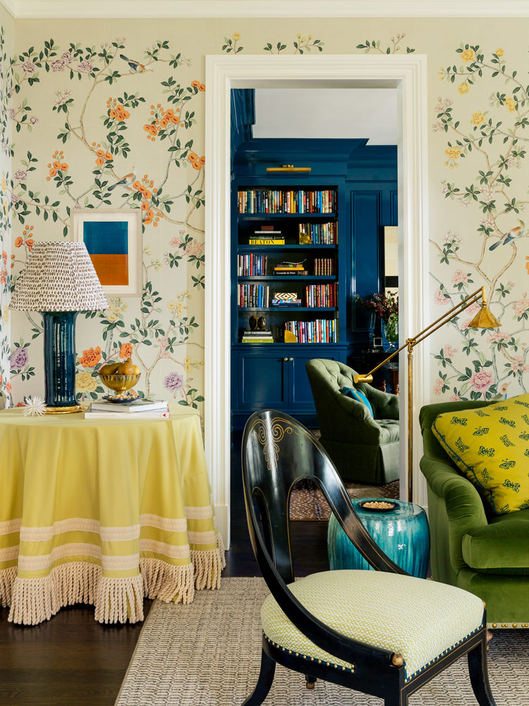 Ashley Whittaker yellow tassel tablecloth floral wallpaper spoon chair turquoise ceramic garden stool