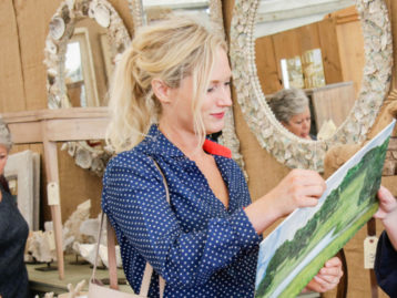 Emily Henderson at Round Top with Vintage Landscape Painting