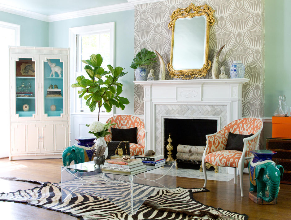 Hollywood Regency Living Room with Baroque Mirror and Zebra Hide Rug