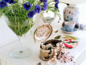 Silver Keepsake Box Organizing Jewelry on a Vanity