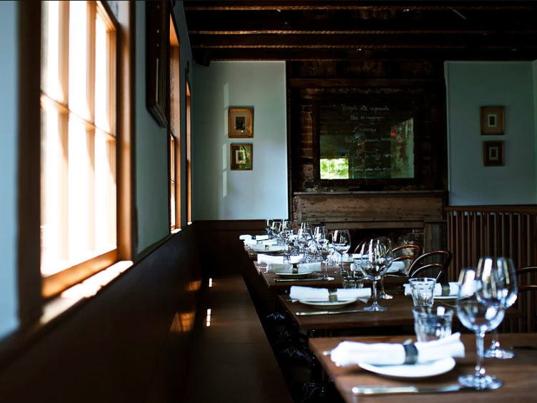 restaurant interior wine glasses fireplace gallery wall design insiders guide to charleston