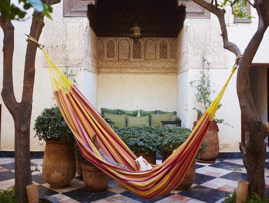 Yellow and Orange Hammock in Outdoor Courtyard