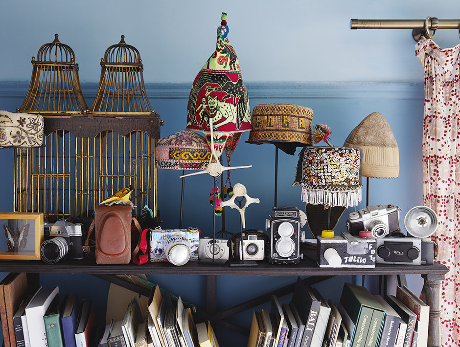 Hats and Camera Displayed in Book Travel Home