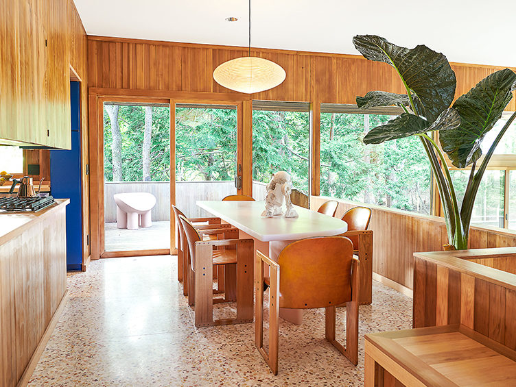 modern dining room, wood paneling, wood kitchen cabinets