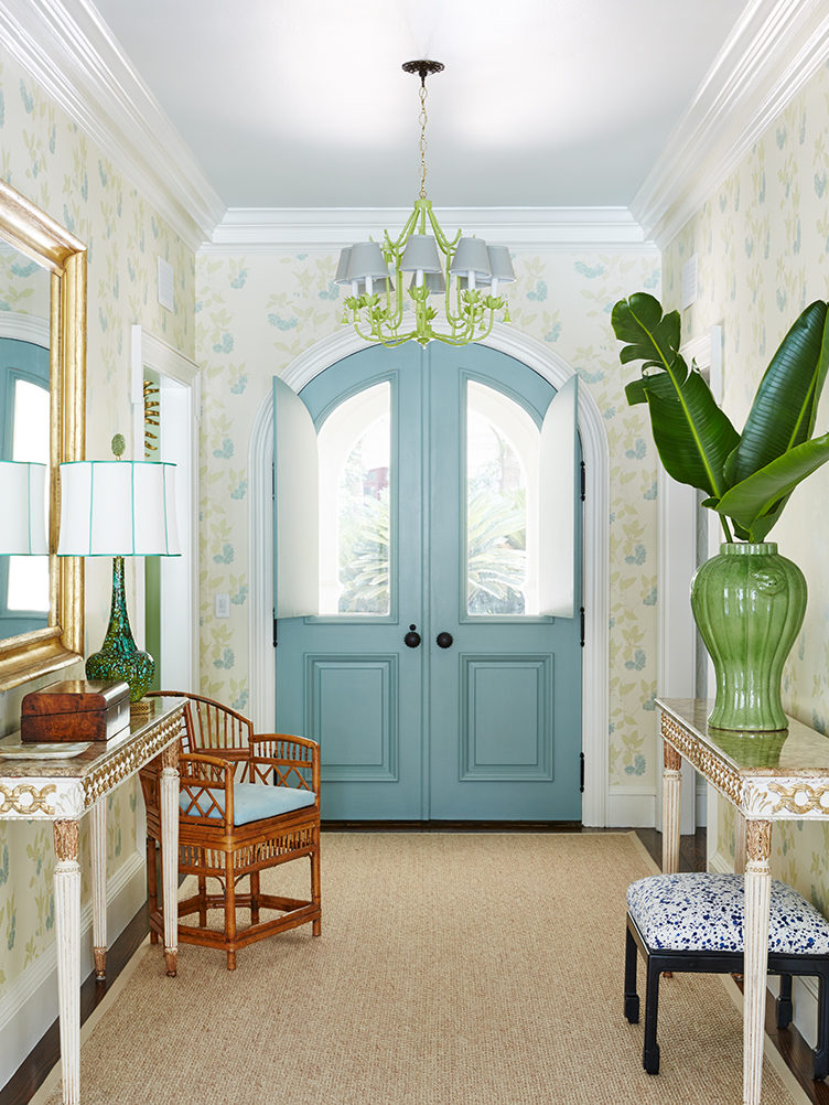 colorful entryway, blue front door, kevin isbell, wallpaper in the entryway, bamboo chair