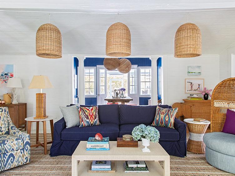 coastal living room, casual living room, kevin isbell, rattan pendants, navy sofa