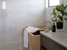 """Mandell and her client chose a customOfuro soaking tub from Zen Bathworks to elevate the fresh design of the master bath; Japanese-style Ofuro tubs are deep enough to sit upright in and are crafted from fragrant wood; in this case, the designer and her client selected a traditional Hinoki wood. """"The light wood tub looks stunning against the marble in the bathroom, and now [the client] can enjoy a steaming bath after a long day,"""" says Mandell."""