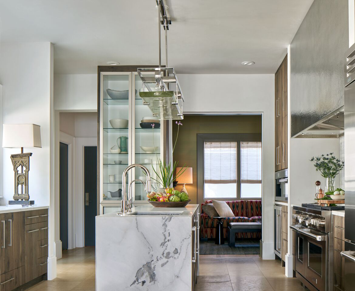 Marble kitchen island and custom cabinetry. by Marcus Mohon Interiors