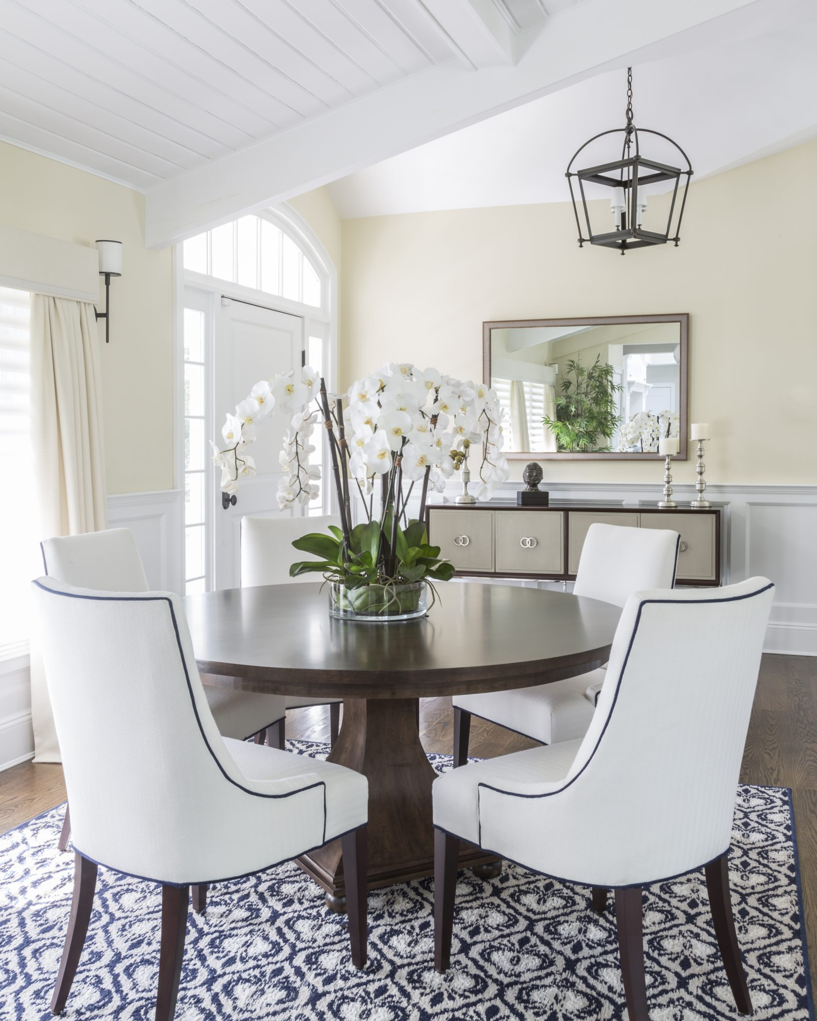 Dining Room, round dining table, upholstered dining chairs & ceiling details. by Kim Radovich Interiors