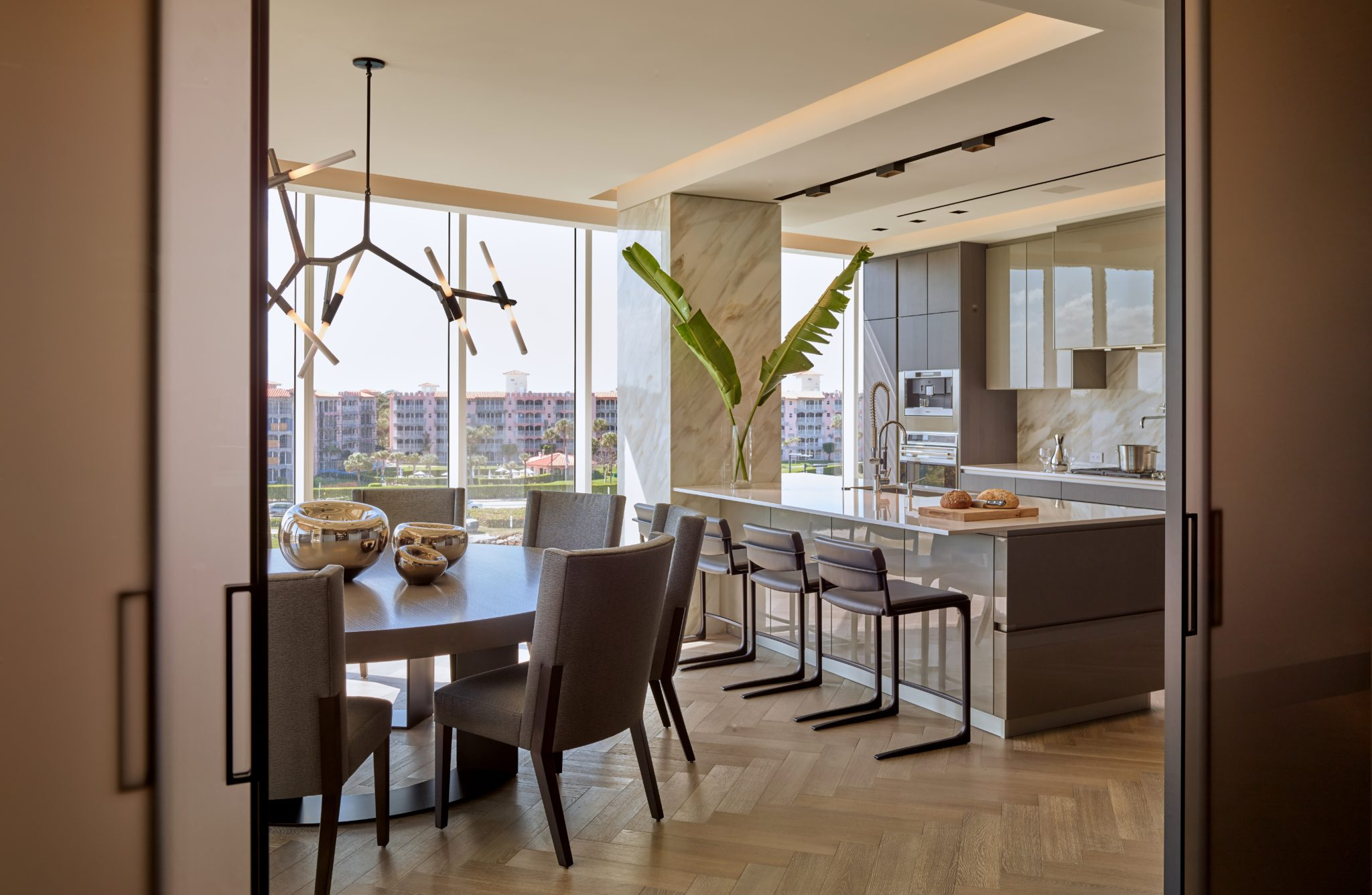 Intracoastal Residence Dining Room & Kitchen by B+G Design