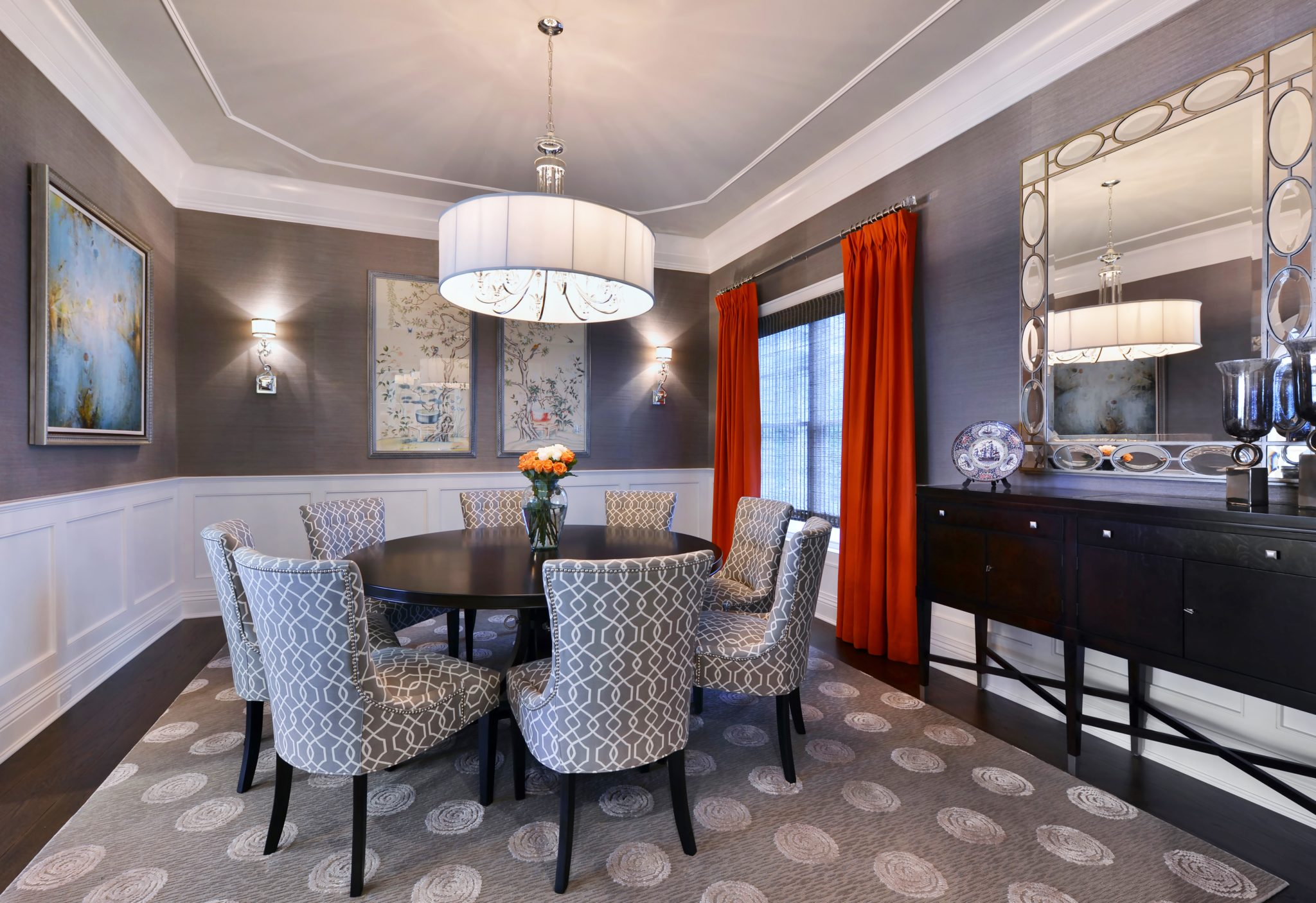 Dining room with stunning art and mirror by Keith Mazzei Interiors