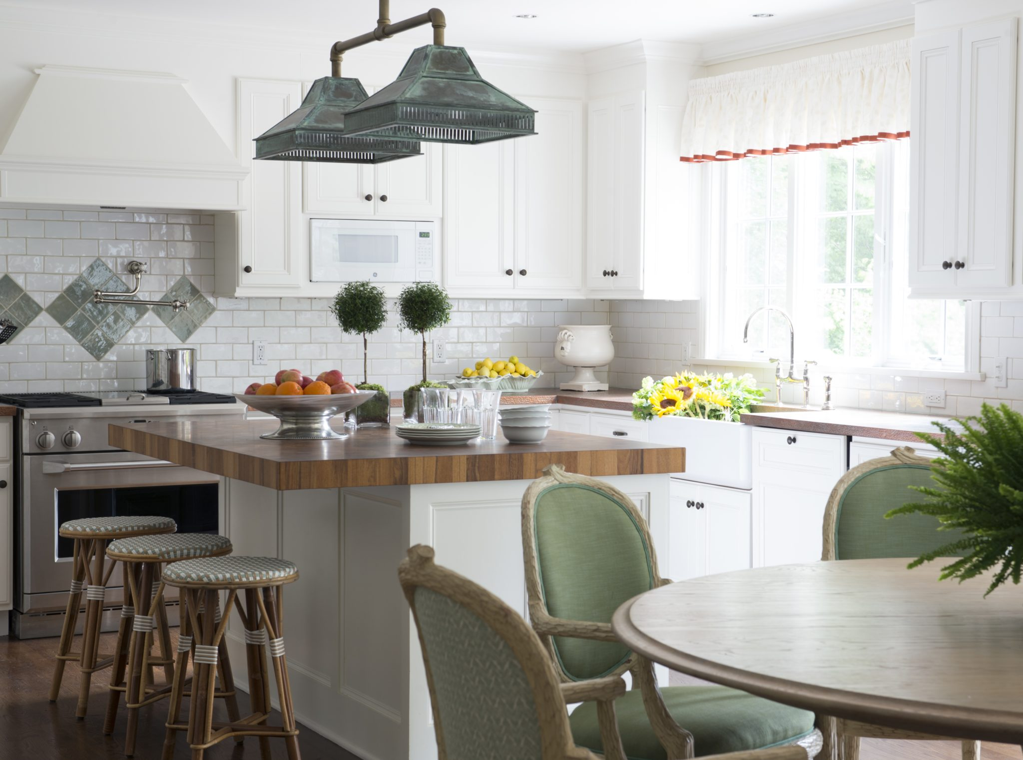 A Charming Kitchen and Dining Room by Allison Caccoma, Inc.
